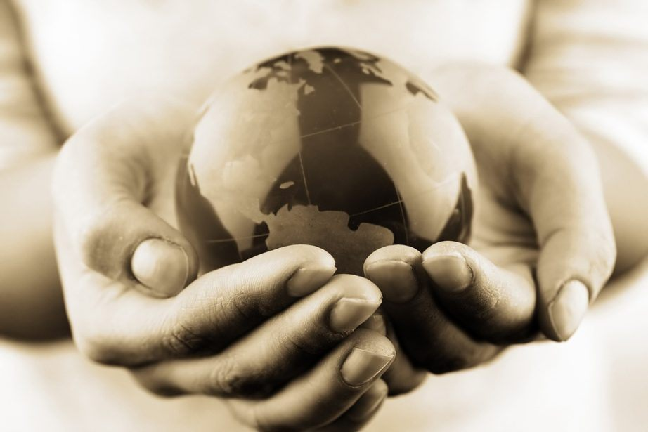 changing the world hands globe sepia