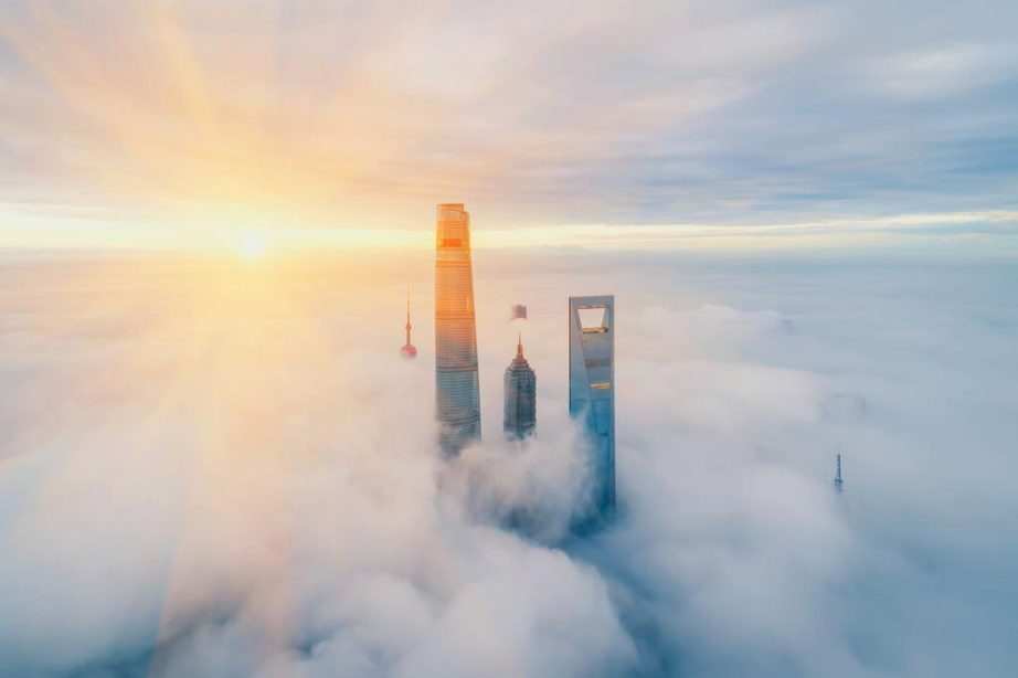 worlds tallest structures shanghai china clouds skyscrapers